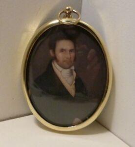 Miniature portrait of gentleman in an oval brass bezel.