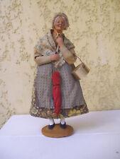 1 santon ancien habillé signé S . Jouglas