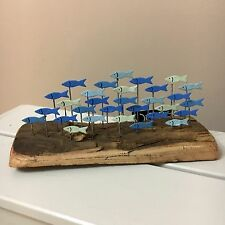 School of anchovies on Drift wood.Shoeless joe.Nautical ornament.Seaside.Coastal