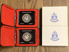 2-  1870-1970 Manitoba, Canada Cased Commemorative Dollars in Original Holders