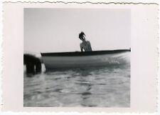 Old photo-woman sea boat blur-woman boat-vintage snapshot