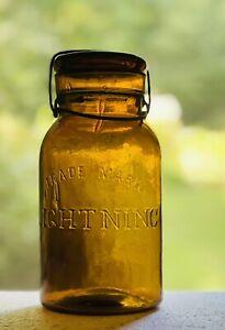 SUPERB TOP SHELF EXAMPLE ORANGE AMBER QUART TRADE MARK LIGHTNING FRUIT JAR