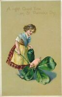ST. PATRICK'S DAY – Girl and Pig Jumping Over Shamrock Tuck Postcard