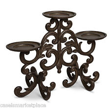 The GG Collection Acanthus Leaf Scrolled Brown Metal 3 Pillar Candle Holder