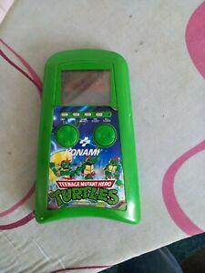 Teenage Mutant Hero Turtles LCD vintage handheld game, average condition.