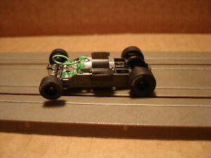 TOMY AFX H.O. SCALE MEGA G+ 1.5 WIDE CHASSIS WITH BLACK RIMS LETTERED TIRES