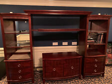 Dark cherry entertainment center used in Good shape