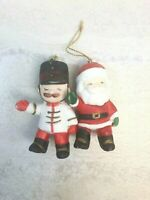 Set of 2 Hand-Painted Bisque Ceramic Christmas Ornament Figurines Santa, Soldier