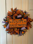 Happy Halloween with spiders wreath. Purple, orange, and black mesh on a 14 in f