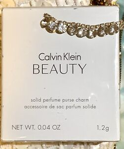 BEAUTY by CALVIN KLEIN SOLID PERFUME PURSE 0.04 OZ WOMEN Sealed New Authentic