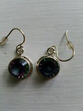 is a quarter inch in diameter Sterling silver Mystic topaz earrings each stone