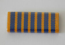 NATIONAL MEDAL RIBBON BAR PLASTIC COVERED. RIBBON BAR HAS 2 PINS