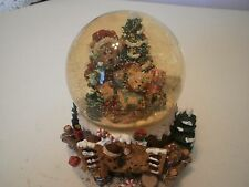 "Teddy Bear Musical Snow Globe music box plays, ""We wish you a Merry Christmas."""