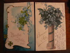2 cpa illustrateur bouquet myosotis trefle gauffree