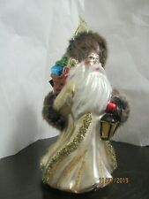 Glass Christmas ornament, beautiful Santa with gifts.