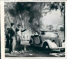 1942 US Soldiers Put Out Fire Burning Australian Auto Press Photo