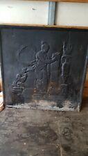 plaque de cheminée ancienne en fonte dans son jus d'origine