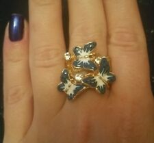 Still and enamel butterfly ring size L.