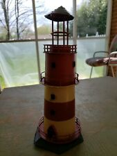 """Lighthouse decor, Hand made and decorated. 11"""" tall."""