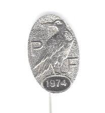 1974 P F oval silvered pin badge - Crow? - BERTRAM maker