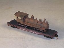 N Scale 50 Foot Flat Car with rusted out 1900 10 wheeler locomotive.