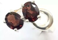 Sterling Silver Ring With Two Oval Garnet Faceted Stones. Size 8.