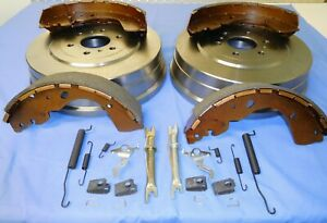 PAIR OF REAR BRAKE DRUMS, SHOES + SPRING KIT FOR 4WD NISSAN NAVARA D40  2007-15