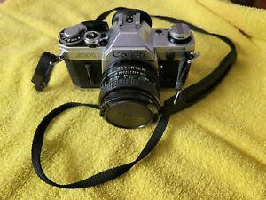 Canon AE-1 Vintage Film Camera with Canon FD 50mm F/1.8 Lens- Silver w/Strap