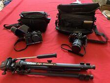 Nikomat & 3EHNT Cameras Plus Tripod And 3 Lenses Plus Accessories..