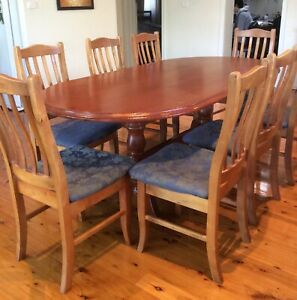 Dining table with 8 chairs, all in solid natural Oregon timber.