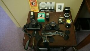 LOT OF 2 35MM CAMERAS WITH LENSES FLASHES FILTER BOOKS UNTESTED USED SOLD AS IS