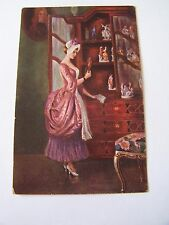 Vintage Postcard Woman Looking at Porcelain Figures Wodzinski