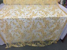 Marvelous feather bridal wedding beaded mesh lace fabric gold. Sold by the yard.