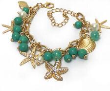 "Goldtone starfish, pearl & seashell charm bracelet, 7"" long pus 3"" extender"