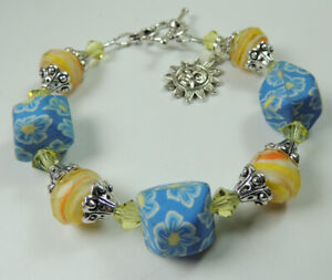Polymer Clay Floral Crystal  Lampwork Bracelet  with Sun Charm Handcrafted
