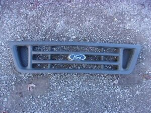 Used grille with badge for 2003-2007 Ford Econoline E-150 van 2C24-8200-B