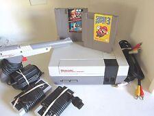 Nintendo NES-001 console Bundle, 2 Mario games, 2 controllers, gun and hookups