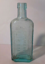 GOMBAULTS CAUSTIC BALSAM -VETERINARY MEDICINE -EMBOSSED-Aqua Glass