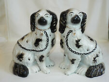 Good large pair of antique Staffordshire Spaniel Dogs.