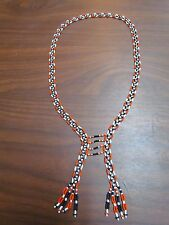 HANDMADE FULLY BEADED NECKLACE, 26 INCHES LONG, BLACK, ORANGE AND WHITE DESIGN