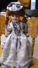 "15"" Porcelain Doll with cloth body"