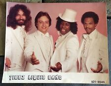 Vintage Tibbz Liquid Band Kodak Photograph Guy Group Local?