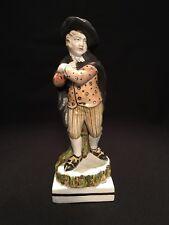 Antique English Staffordshire porcelain figure of a boy skater