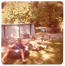 Vintage 70s PHOTO Pair Teen Boys Guys Sitting In Inner Tubes In Park Outdoors