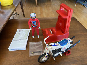 1975 Ideal EVEL KNIEVEL Stunt Cycle Figure, Energizer, Swagger Stick & Stunt Bar