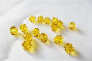 20 x 6mm Crystal Cut Glass Bicone Beads: BNCC18 Amber