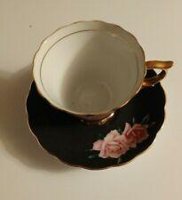 VINTAGE MADE IN JAPAN FLOWERED MATTE BLACK TEA CUP AND SAUCER