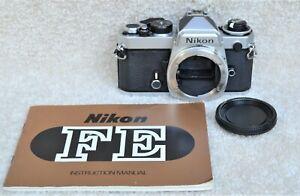 Nikon FE 35mm Film Camera Body w/ Cap and Manual - Working