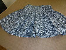 GIRLS SHORT FLAIRED SKIRT. IN BLACK/GREY. SIZE 8. 100% COTTON.