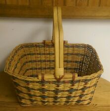 Woven basket with wooden handles